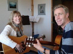 Michele taking a guitar lesson with Steve Giltrow